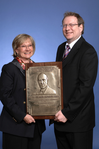 DeAnn Craig, president of the American Institute of Mining, Metallurgical, and Petroleum Engineers (AIME), presents Mike with the Hal Williams Hardinge Award, 2 March 2011, Denver.